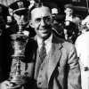 Photo - FILE - In this Sept. 5, 1931, file photo, Francis Ouimet of Boston, Ma., poses with his trophy after winning the U.S. Amateur Golf tournament at the Beverly Country Club in Chicago, Ill. In what remains one of the most celebrated U.S. Opens in history, Francis Ouimet put American golf on the map by bringing down two titans. (AP Photo/File)
