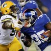 New York Giants\' Andre Brown (35) rushes past Green Bay Packers\' Dezman Moses (54) during the first half of an NFL football game, Sunday, Nov. 25, 2012, in East Rutherford, N.J. (AP Photo/Bill Kostroun)