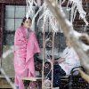 Cami Ericksen, 13, and her mother Tammy come out on their porch to watch firemen clear the street on Friday, Jan. 29, 2010, in Purcell, Okla. They have had no power or heat in their house since 2:00 pm. Thursday after a winter storm. Photo by Steve Sisney, The Oklahoman