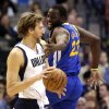 Dallas Mavericks power forward Dirk Nowitzki (41) of Germany is defended by Golden State Warriors small forward Draymond Green (23)during the first quarter of an NBA basketball game Saturday, Feb. 9, 2013, in Dallas. (AP Photo/LM Otero)