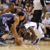 Charlotte Bobcats guard Gerald Henderson (9) gets to a loose ball in front of Dallas Mavericks guard Darren Collison (4) and Bobcats guard Kemba Walker (15) in the first half during an NBA basketball game on Saturday, Nov. 3, 2012, in Dallas. (AP Photo/Matt Strasen)