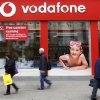 Photo - FILE - In this Tuesday, May 19, 2009, file photo, people walk by a branch of Vodafone in central London. Verizon says, Monday, Sept. 2, 2013, it has agreed to buy Vodafone's stake in Verizon Wireless for $130 billion. (AP Photo/Sang Tan, File)