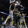 Creighton\'s Zach Hanson (40) has his shot blocked by Baylor\'s Cory Jefferson (34) as Isaiah Austin (21) defends during the first half of a third-round game in the NCAA college basketball tournament Sunday, March 23, 2014, in San Antonio. (AP Photo/David J. Phillip)