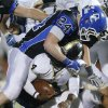 Deer Creek\'s Kooper Ruminer brings down McAlester\'s Jarome Smith during a high school football playoff game at Deer Creek, Friday, Nov. 16, 2012. Photo by Bryan Terry, The Oklahoman
