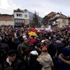 In this picture taken Sunday, Jan. 13, 2013, people crowd the main square in Macedonia\'s southwestern village of Vevcani during the carnival parade. Said to date from pagan times 1,400 years ago, the Vevcani carnival, with its colorful floats and masked revelers, has grown in popularity over the last decade and attracts thousands of visitors for the celebrations on St. Vasilij Day to welcome in the New Year according to the Julian calendar. (AP Photo/Boris Grdanoski)