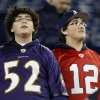 Photo - Brothers Cameron Ibarra, left, wearing the jersey of Baltimore Ravens inside linebacker Ray Lewis, and Sabastian Ibarra, right, wearing the jersey of New England Patriots quarterback Tom Brady, watch warm-ups before the NFL football AFC Championship football game between the Ravens and Patriots in Foxborough, Mass., Sunday, Jan. 20, 2013. (AP Photo/Stephan Savoia)