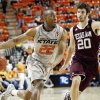 OSU\'s Markel Brown (22) drives to the basket as Texas A&M\'s Daniel Alexander defends during a men\'s college basketball game between the Oklahoma State University Cowboys and Texas A&M University Aggies in Stillwater, Okla., Saturday, Feb. 25, 2012. OSU won, 60-42. Photo by Nate Billings, The Oklahoman
