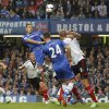 Photo - Chelsea's John Terry, third right, jumps to head the ball during the English Premier League soccer match between Chelsea and Fulham at Stamford Bridge, London, Saturday, Sept. 21, 2013. (AP Photo/Sang Tan)