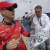 NASCAR driver Kevin Harvick signs autographs for fans prior to qualifying at the Talladega Superspeedway in Talladega, Ala., Saturday, Oct. 6, 2012. The drivers were qualifying for the Sunday running of the NASCAR Sprint Cup Series auto race. (AP Photo/Dave Martin)