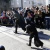 """Miles Scott, 5, dressed as Batkid, follows Batman as they go to rescue a damsel in distress in San Francisco, Friday, Nov. 15, 2013. San Francisco turned into Gotham City on Friday, as city officials helped fulfill Scott\'s wish to be """"Batkid.""""Â Scott, a leukemia patient from Tulelake in far Northern California, was called into service on Friday morning by San Francisco Police Chief Greg Suhr to help fight crime, The Greater Bay Area Make-A-Wish Foundation says. (AP Photo/Bay Area News Group, Gary Reyes)"""