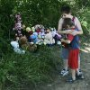 Dakota Padgett, 10, hugs his brother, Devon Padgett, 7, in front of a memorial on the side of the road for Skyla Whitaker, 11, and Taylor Paschal-Placker, 13, on Wednesday, June 11, 2008. The two girls were found murdered Sunday night. (AP Photo)
