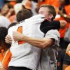 Oklahoma State\'s J.W. Walsh (4) leaps into the stands to hug his friend Chase Wolfle after the AdvoCare Texas Kickoff college football game between the Oklahoma State University Cowboys (OSU) and the Mississippi State University Bulldogs (MSU) at Reliant Stadium in Houston, Saturday, Aug. 31, 2013. OSU won, 21-3. Photo by Nate Billings, The Oklahoman