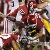 Oklahoma\'s Sam Proctor (27), Marshall Musil (20), and Trey Millard (33) bring down Iowa\'s Keenan Davis (6) during the Insight Bowl college football game between the University of Oklahoma (OU) Sooners and the Iowa Hawkeyes at Sun Devil Stadium in Tempe, Ariz., Friday, Dec. 30, 2011. Photo by Bryan Terry, The Oklahoman