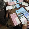 In this Nov. 1, 2012 photo, volunteers in Minneapolis prepare Democratic campaign flyers for the Obama-Biden ticket in a ground game blitz to get out the vote with