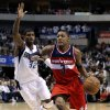 Washington Wizards\' Bradley Beal (3) gets by Dallas Mavericks\' O.J. Mayo (32) on a drive to the basket for a shot in the first half of an NBA basketball game, Wednesday, Nov. 14, 2012, in Dallas. (AP Photo/Tony Gutierrez)