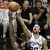 San Antonio Spurs\' Manu Ginobili (20), of Argentina, defends a shot by Miami Heat\'s LeBron James (6) during the first half at Game 4 of the NBA Finals basketball series, Thursday, June 13, 2013, in San Antonio. (AP Photo/David J. Phillip)