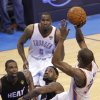 Oklahoma City\'s Kevin Durant (35) puts up the last shot over Miami\'s LeBron James (6) and Chris Bosh (1) during Game 2 of the NBA Finals between the Oklahoma City Thunder and the Miami Heat at Chesapeake Energy Arena in Oklahoma City, Thursday, June 14, 2012. Photo by Chris Landsberger, The Oklahoman