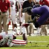 Oklahoma\'s Javon Harris (30) upends TCU\'s B.J. Catalon (23) during the college football game between the University of Oklahoma Sooners (OU) and the Texas Christian University Horned Frogs (TCU) at Amon G. Carter Stadium in Fort Worth, Texas, on Saturday, Dec. 1, 2012. Photo by Steve Sisney, The Oklahoman