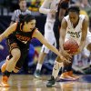 Oklahoma State\'s Brittney Martin (22) goes for the ball beside Baylor\'s Brooklyn Pope (32) during the Big 12 tournament women\'s college basketball game between Oklahoma State University and Baylor at American Airlines Arena in Dallas, Sunday, March 10, 2012. Oklahoma State lost 77-69. Photo by Bryan Terry, The Oklahoman