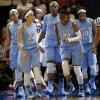 Photo - North Carolina guard Diamond DeShields (23) reacts after injuring herself during the first half of a regional semifinal against South Carolina at the NCAA college basketball tournament in Stanford, Calif., Sunday, March 30, 2014. (AP Photo/Marcio Jose Sanchez)