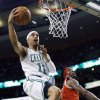 Boston Celtics\' Courtney Lee (11) shoots past Milwaukee Bucks\' Marquis Daniels, right, in the first quarter of an NBA basketball game in Boston, Friday, Dec. 21, 2012. (AP Photo/Michael Dwyer)