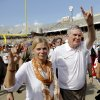 Texas coach Mack Brown walks off the field with his wife Sally as they salute the fans after the 36-20 win over Oklahoma during the Red River Rivalry college football game between the University of Oklahoma Sooners (OU) and the University of Texas Longhorns (UT) at the Cotton Bowl Stadium in Dallas, Saturday, Oct. 12, 2013. Photo by Chris Landsberger, The Oklahoman