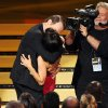 "Bryan Cranston, left, kisses Julia Louis-Dreyfus as she accepts the award for outstanding lead actress in a comedy series for her work on ""Veep"" at the 66th Annual Primetime Emmy Awards at the Nokia Theatre L.A. Live on Monday, Aug. 25, 2014, in Los Angeles. (Photo by Chris Pizzello/Invision/AP)"