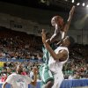 Photo - Haworth's Quinton Threadgill goes to the basket between Northeast's Jalen Pugh, left, and Omarkio Collins during the Class 2A boys high school state basketball championship game at State Fair Arena in Oklahoma City, Saturday, March 10, 2012. Photo by Bryan Terry, The Oklahoman