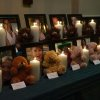 Candles and teddy bears accompany pictures of each of the Sandy Hook Elementary victims during a vigil in Pearland, Texas Friday, Dec. 21, 2012.(AP Photo/The Courier, Kirk Sides) ORG XMIT: TXCON110