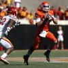 Oklahoma State\'s J.W. Walsh (4) is scrambles as he is pressured by Iowa State\'s Jeremiah George (52) during a college football game between Oklahoma State University (OSU) and Iowa State University (ISU) at Boone Pickens Stadium in Stillwater, Okla., Saturday, Oct. 20, 2012. Photo by Sarah Phipps, The Oklahoman