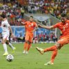 Photo - Netherlands' Robin van Persie, right, takes a shot during the World Cup quarterfinal soccer match between the Netherlands and Costa Rica at the Arena Fonte Nova in Salvador, Brazil, Saturday, July 5, 2014. (AP Photo/Felipe Dana)