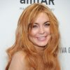 Photo - FILE - In this Feb. 6, 2013 file photo,  Lindsay Lohan attends amfAR's New York gala at Cipriani Wall Street in New York.  Lohan is due back in court on Monday March 18, 2013 for a hearing that will lay out when her trial will begin on misdemeanor charges she lied to police and was driving recklessly when her sports car crashed in June 2012. Lohan's trial is scheduled to begin this week, but her attorney has previously sought a delay. (Photo by Evan Agostini/Invision/AP, File)