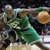 Boston Celtics\' Kevin Garnett (5) tries to control the ball during the fourth quarter of an NBA basketball game against the New Jersey Nets in Newark, N.J., Saturday, April 14, 2012. Garnett had 21 points in the Celtics\' 94-82 win. (AP Photo/Mel Evans)