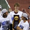 Photo - USC and Max de Vroome, center, celebrates their men's team NCAA Division I tennis championships after defeating Oklahoma, Tuesday, May 20, 2014, in Athens, Ga. (AP Photo/David Tulis)