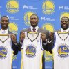 New Golden State Warriors draft picks Harrison Barnes, left, a forward from North Carolina, Festus Ezeli, center, a center from Vanderbilt, and Draymond Green, right, a forward from Michigan State, holds up their jerseys during a news conference at Warriors headquarters in Oakland, Calif., Monday, July 2, 2012. (AP Photo/Paul Sakuma)