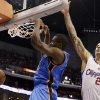 Oklahoma City Thunder forward Serge Ibaka (9), of the Republic of Congo, dunks as Los Angeles Clippers forward Matt Barnes (22) defends in the second half of an NBA basketball game in Los Angeles, Sunday, March 3, 2013. The Thunder won 108-104. (AP Photo/Reed Saxon)
