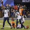 Photo - Seattle Seahawks' Kam Chancellor (31) celebrates after intercepting a pass intended for Denver Broncos tight end Julius Thomas (80) during the first half of the NFL Super Bowl XLVIII football game Sunday, Feb. 2, 2014, in East Rutherford, N.J. (AP Photo/Gregory Bull)