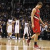 Portland Trail Blazers\' Meyers Leonard, right, walks off the court dejectedly during the second half of an NBA basketball game against the Phoenix Suns, Wednesday, Nov. 21, 2012, in Phoenix. The Suns defeated the Trail Blazers 114-87. (AP Photo/Ross D. Franklin)