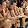 The Louisville Cardinal bench watches as UConn accepts their trophy for winning an NCAA college basketball game in the finals of the American Athletic Conference women\'s basketball tournament, Monday, March 10, 2014, in Uncasville, Conn. Connecticut won 72-52. (AP Photo/Jessica Hill)