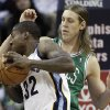Photo - Boston Celtics' Kelly Olynyk, of Canada, right, defends against Memphis Grizzlies' Ed Davis (32) in the first quarter of an NBA basketball game in Memphis, Tenn., Monday, Nov. 4, 2013. (AP Photo/Danny Johnston)