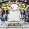 This Jan. 12, 2013 photo provided by NASA shows the Dragon spacecraft inside a processing hangar at Cape Canaveral Air Force Station in Cape Canaveral, Fla. where teams had just installed the spacecraft\'s solar array fairings. The California company known as SpaceX is scheduled to launch its unmanned Falcon rocket on Friday morning, March 1, 2013, carrying a Dragon capsule containing more than a ton of food, tools, computer hardware and science experiments. (AP Photo/NASA, Kim Shiflett)