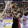 Toronto Raptors\' DeMar DeRozan, center, cannot get a shot past Philadelphia 76ers\' Spencer Hawes, left, and Jason Richardson in the first half of an NBA basketball game, Tuesday, Nov. 20, 2012, in Philadelphia. (AP Photo/Matt Slocum)