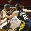 Oklahoma\'s Aaryn Ellenberg (3) goes past Michigan\'s Kate Thompson (12) during a first round game of the NCAA women\'s basketball tournament between the University of Oklahoma Sooners and the Michigan Wolverines at Lloyd Noble Center in Norman, Okla., Sunday, March 18, 2012. Oklahoma won 88-67. Photo by Bryan Terry, The Oklahoman