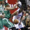 Boston Celtics\' Paul Pierce (34) and Philadelphia 76ers\' Thaddeus Young (21) fight for a loose ball in the first half of an NBA basketball game, Tuesday, March 5, 2013, in Philadelphia. (AP Photo/H. Rumph Jr)