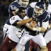Photo -   Connecticut quarterback Chandler Whitemer, right, is pulled down by Massachusetts' Tom Brandt in the second half of an NCAA college football game in East Hartford, Conn., Thursday, Aug. 30, 2012. Connecticut won 37-0. (AP Photo/Jessica Hill)