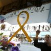 Jammi Parris, a waitress at the Blue Bird Cafe in downtown Arlington, Wash., paints a yellow ribbon and the words