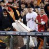 San Francisco Giants first baseman Brandon Belt makes a diving catch into the stands on a ball hit by Cincinnati Reds\' Zack Cozart in the first inning of Game 1 of the National League division baseball series in San Francisco, Saturday, Oct. 6, 2012. (AP Photo/Marcio Jose Sanchez)