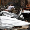 Neighbors hug amid the tornado damage in Petal, Miss., Tuesday, Feb. 12, 2013, as cleanup continues following the Sunday afternoon tornado that caused damage throughout the community. (AP Photo/Rogelio V. Solis)