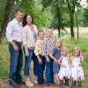 In this Aug. 19 photo, Rep. Markwayne Mullin and his wife, Christie, pose with their children, from left, Jim, Andrew, Larra, Ivy and Lynette. The Mullins' adoption of Ivy and Lynette was finalized Aug. 21. See story on Page 10A. PHOTO PROVIDED