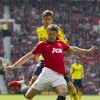 Photo - Manchester United's Michael Carrick, foreground, keeps the ball from Sunderland's Marcos Alonso during their English Premier League soccer match at Old Trafford Stadium, Manchester, England, Saturday May 3, 2014. (AP Photo/Jon Super)